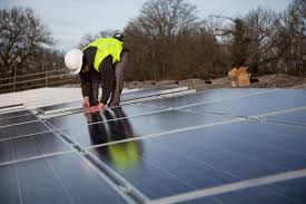 solar farm builders on roof
