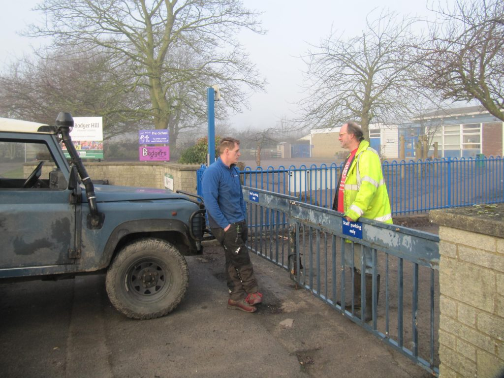 John Cossham talking to contractor to stop trees being cut down at Badger Hill School